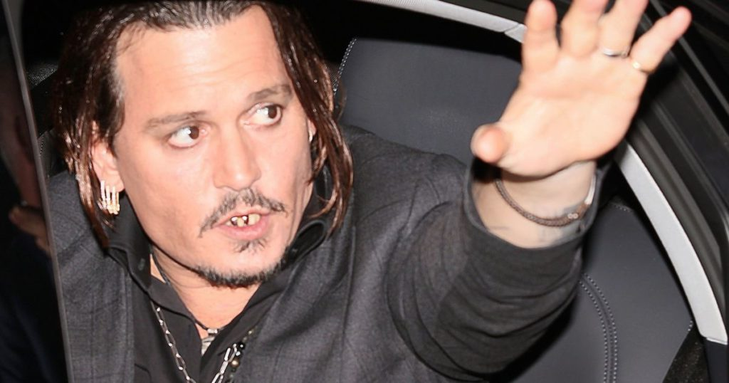 Johnny Depp waves goodbye showing gold teeth, veneers, gold capped teeth